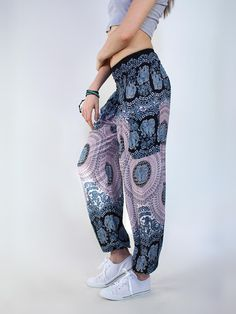 Black and pink women's bohemian elephant print harem pants from Thailand with 2 pockets. 10% of net profits are donated to help prevent elephant poaching.