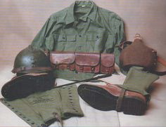 French Uniform worn in 1943 - mixture of French and American issue. Herringbone twill uniform with French model 1926 helmet and cartridge belt model 1936