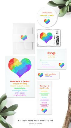 Happy and colorful gay or lesbian wedding invitation with a rainbow heart.
