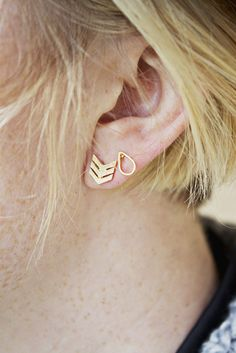 Triple Chevron Studs.  This site has a bunch of cute earrings!