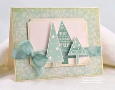 Tonight I used a couple of Papertrey Ink stamp sets, Trees with Trimmings and 2010 Holiday Tags for the sentiment on the far right tree. Papers are from Cosmo Cricket's Mitten Weather Mini Deck, and ribbon white seam binding, Copic reinker-dyed with a BG 72 and and E40. Ink for the trees is PTI's Ocean Tides, Versamagic Oasis Green, and Adirondack Bottle for the sentiment.
