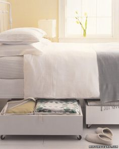 Try Under-the-Bed Baskets: Instead of haphazardly shoving random items beneath your bed, make the most of your floor space by using under-the-bed storage. This would be a great spot to stow extra bed linens, exercise gear, or even handbags.  Photo courtesy of Martha Stewart