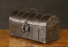A 15th Century French Leather Clad Casket. The rectangular dome-topped cask