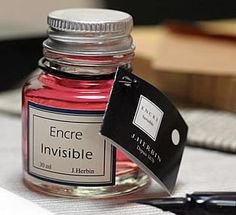 """Invisible Ink (""""Encre Sympathique"""") The ink turns blue when held under a light or other heat source. Writing disappears as the paper cools. J. Herbin started making invisible ink in 1993. It's made of mineral water, and cobalt chloride. Cobalt chloride dissolves in water, giving it a light pink color that is so pale you can't see if when you write on paper."""