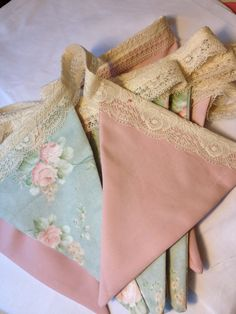 I don't know what it is...I just love these type of banners in floral paper, chintz fabric or this one with vintage lace ~ bunting.