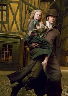Hugh Jackman & Isabelle Allen in Les Miserables Cast photo by Annie Leibovitz for Vogue December 2012