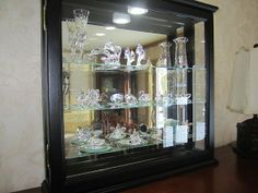Tabletop models will hold only a few items or if you take out the shelves the curio can be used as a doll display case. Wall Curio Cabinet, Curio Cabinets, Wood Cabinets, Led Puck Lights, Wall Lights, Ogee Edge, Swarovski Crystal Figurines, Cabinet Dimensions, Wall Boxes