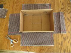 how to cover boxes with fabric - Google Search....Use the boxes for storage in laundry room!