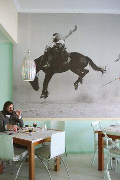 mint wall + big photo of cowboy