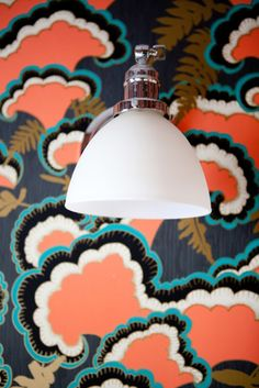 Uniquely patterned wallpaper with cool pendant ceiling light