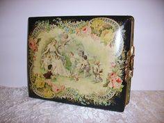 Late 1800's Antique Art Nouveau Maiden & Cherubs Celluloid Photo Album and Photos 1800's // Etsy. $145.00