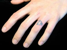 Tattooed engagement diamond on the ring finger (So cute!)