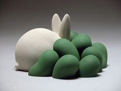 Greener Greens (The White Rabbit) by Jeremy Brooks 2006 Description: Altered paint-your-own ceramic figurine. Process: Slip-casting, painting, scenting. Materials: Porcelain, paint, underglaze, paraffin wax, fragrance (grass). (This figurine is infused with the aroma of freshly cut grass.) Honors: Winner of a 2008 NICHE Student Award.