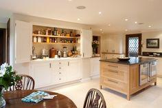 """larder"" cabinet. bi-fold doors, marble counter top/workspace, appliance storage w/ outlets. (by figura)"