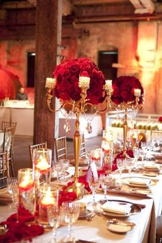 Gold candelabras with red flowers as centerpieces- red and gold wedding inspiration
