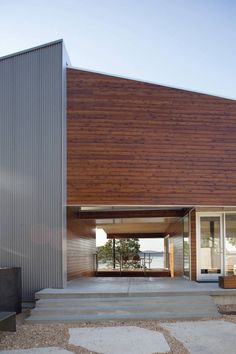 Aluminum + Western Red Cedar... Postcard House / Hufft Projects