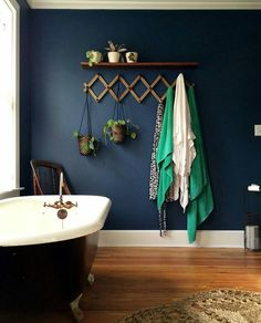 Dark walls, white trim, green accents - bathroom inspiration +Blog: Curb Appeal + Front Porch Reno (I)