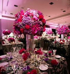Like the idea of the talk but don't like the vase or the flowers, on tables with high flower use low votives with glitter