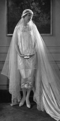 Edna Johnson wearing a bridal gown designed by Callot Soeurs: silver-brocade satin two-piece dress and train, lace wing sleeves, and a tulle veil held close to the head with a circle of orange blossoms. Stock Photo Date Photographed:ca. Vintage Outfits, Vintage Gowns, Vintage Mode, Vintage Fashion, Vintage Wedding Photos, Vintage Bridal, Vintage Weddings, Chic Vintage Brides, Country Weddings