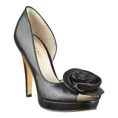 """d'Orsay peep toe pump with rosette detail. All leather upper on a 4 1/4'' heel and 3/4"""" platform."""
