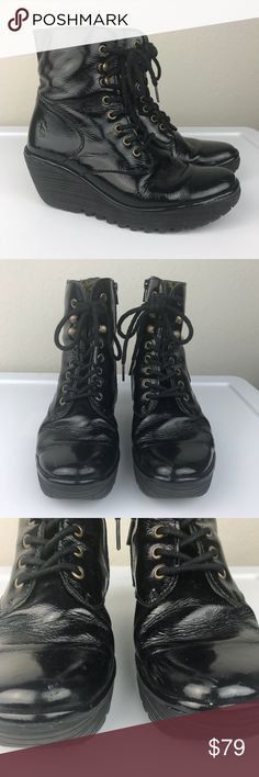 Fly London YGOT Patent Leather Lace Up Wedge Boots Fly London black shiny patent leather lace up boots with signature Fly London Wedge Platform Sole. So comfortable for walking long distances. Great used condition, they are size 39 so use the Fly London sizing guide. Best for an 8.5. Made in Portugal Fly London Shoes Lace Up Boots