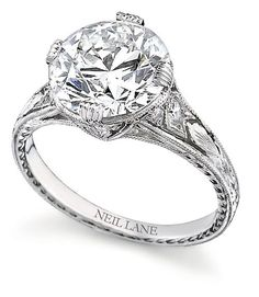 1920 Vintage Wedding Rings | Round diamond set in hand-engraved platinum, by Neil Lane .