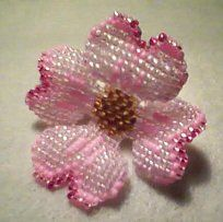 pink dogwood brooch pin (finished piece)  this is slightly altered from the dogwood blossom pattern that i've pinned on my beadwork board.   *to get the 3-dimensional shape of this piece once finished, i used 2-3 coats of clear nail polish a shaped the petals while the polish was drying.