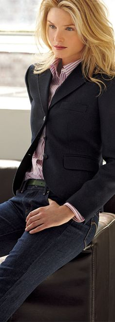 The core wardrobe should contain a navy blazer and an oxford shirt. As seen here, this makes a striking outfit with jeans, but these two pieces can be combined in multiple ways with other wardrobe pieces to create many looks.