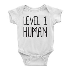 Celebrate the beginning of your childs adventure with a Level 1 Human DnD baby onesie by Level1Gamers. Your brave tot will need time to develop into their future character class; however, theyre starting small for now. Makes a great baby shower gift for those geek friends you know or Dungeons And Dragons, Vintage Outfits, Onesies, Baby Onesie, Human Babies, Hipster, Diy Shirt, Gender Reveal, Baby Shower Gifts