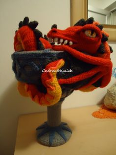 Colours of this dragon are great and I love the way he is resting around the grail. If I could change something I would probably make the head a bit shorter or place the eye a in a bit different way. Otherwise, imo, Gudrun Kulich aka Amigurumi Artist has done a great job.