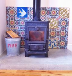Encaustic tiles for fireplace / log burner with polished concrete hearth. Pimpin' out the house