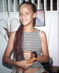 Rihanna adolescente antes de ser famosa.