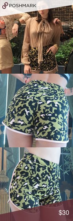 Topshop shorts Topshop shorts. Olive green camo print hot pants with pale pink piping and pockets . Size 2.(EUC) Topshop Shorts