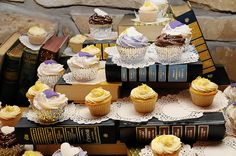 @Amanda Balcer cupcake stand made out of books? You could even spray paint them all one color too! interesting!