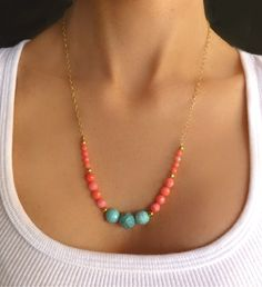"Turquoise stones and gorgeous pink coral faceted beads dangle from this soft yet bold necklace - The beads vary in shades of turquoise and corals - Necklace is shown at a length of 20"" and is availabl"