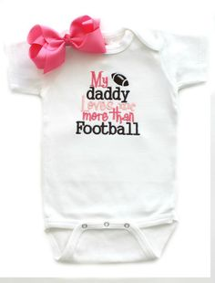 https://www.etsy.com/listing/174666154/daddy-loves-me-more-than-football-with   Daddy Loves Me More Than Football with Bow  by AllThatSassBoutique, $21.00