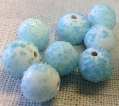 A personal favorite from my Etsy shop https://www.etsy.com/listing/241378894/aqua-sugar-vintage-glass-beads-made-in