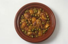 Moroccan tagines such as this one with chicken, and potatoes make delicious meals, with a presentation that is impressive enough for company.