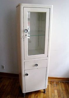 Old Metal Windowed Cabinet