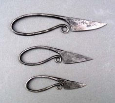 Viking women's knives, kept suspended from belt or brooch, useful for textile crafts and everyday chores.