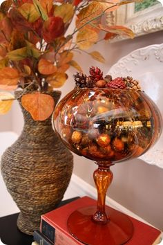 Simple idea. Nice amber glassware.  A simple glass vase can be covered in twine for this.