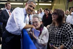 Carolina Garcia Delfin, 94, a Filipina nurse who fought in the resistance against Japanese forces during World War II, kisses President Barack Obama after he mentioned her in his remarks to American and Philippine troops at Fort Bonifacio in Manila, Philippines, April 29, 2014.