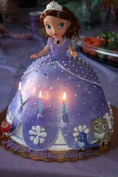 Princess Sofia cake!  Grandma bought the Sofia doll with animals and brought them to a bakery and they made this.  Everyone absolutely loved it, especially princess Maddie!