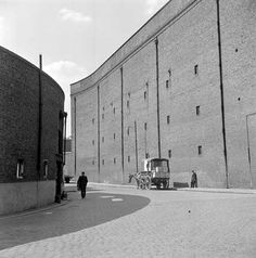The perimeter wall of St Katharine's Dock, Wapping, opened in was designed to ensure security in the dock, photo from late Vintage London, Old London, Candid Photography, Street Photography, Saint Katherine, London Docklands, East End London, London History, London Places