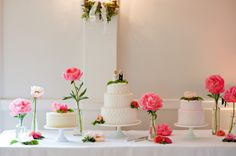 Sweet pink peonies adorn the cake table of this spring wedding.  Floral designs by Floret || Photo by Joann Arruda