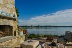 An outdoor seating area with a fireplace and views of the Severn River. Crownsville, MD Coldwell Banker Residential Brokerage $2,795,000