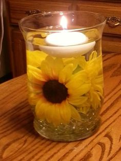 Atmosphere - Sunflower Centerpieces With Candles Light Up The Barn Reception Area. Sunflower Party, Sunflower Baby Showers, Purple Sunflower Wedding, Fall Sunflower Weddings, Sunflower Wedding Centerpieces, Wedding Flowers, Simple Centerpieces, Sunflower Decorations, Centerpiece Ideas
