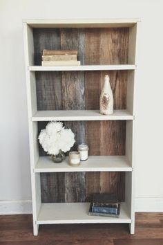 use old wood as a backdrop to a simple bookcase.