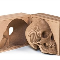 Vince the Human Skull recycled cardboard sculpture from POPmart