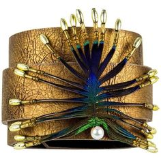 Preowned Stylized Peacock Feather Pendant On Leather Cuff (395 CAD) ❤ liked on Polyvore featuring jewelry, bracelets, brown, peacock jewellery, cuff bangle, pendant jewelry, peacock jewelry and peacock feather jewelry